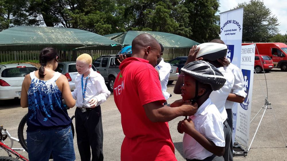 Eager learners were fitted with cycle helmets before embarking on their rider. Photo: supplied