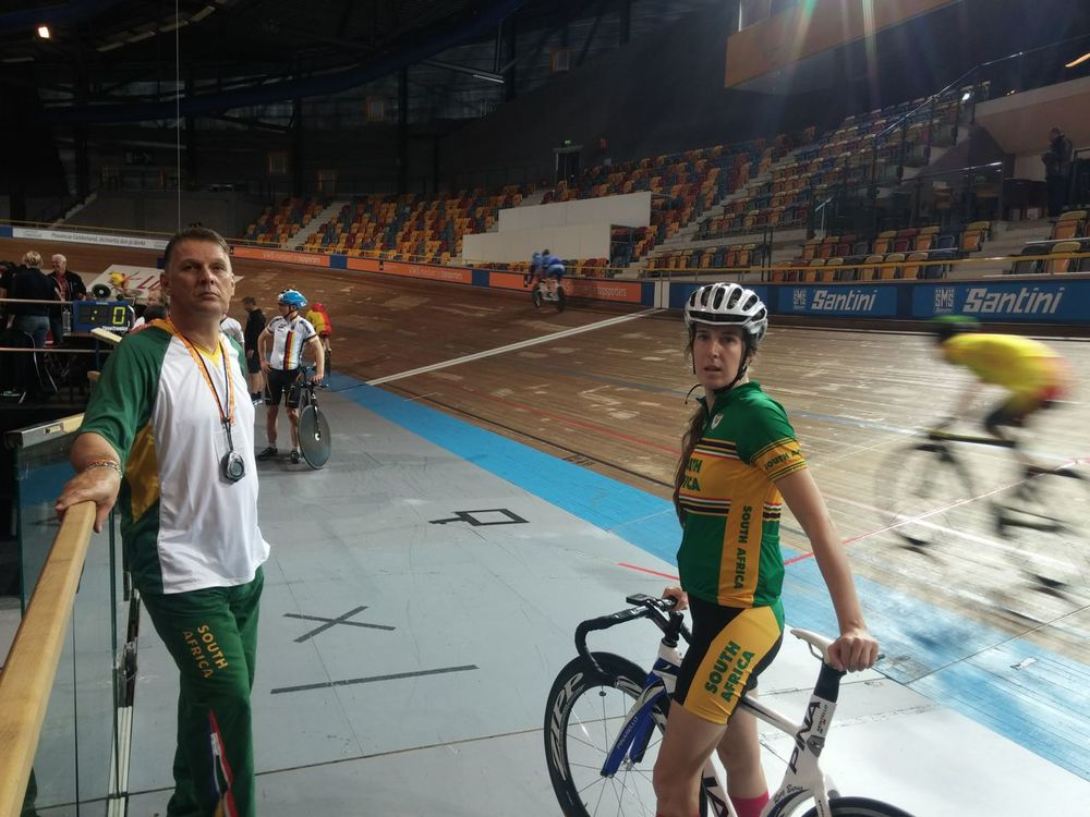 Roxy Burns (with coach Corne Bence) is very satisfied with her two 5th place finishes in the 2015 track World Championships. Photo: Supplied.
