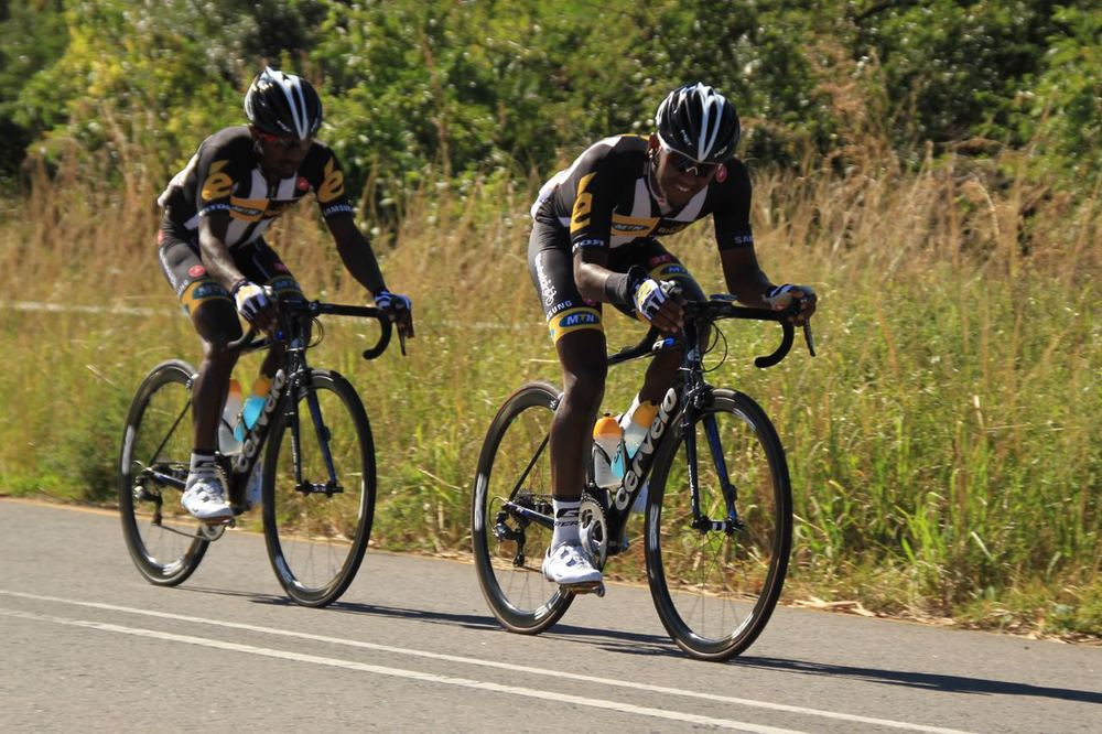 An early breakaway was made by MTN-Qhubeka Feeder Team riders Tesfom Okubamariam and Clint Hendriks (front) at the May Day Classic in Margate on Friday 1 May 2015. Photo: Supplied