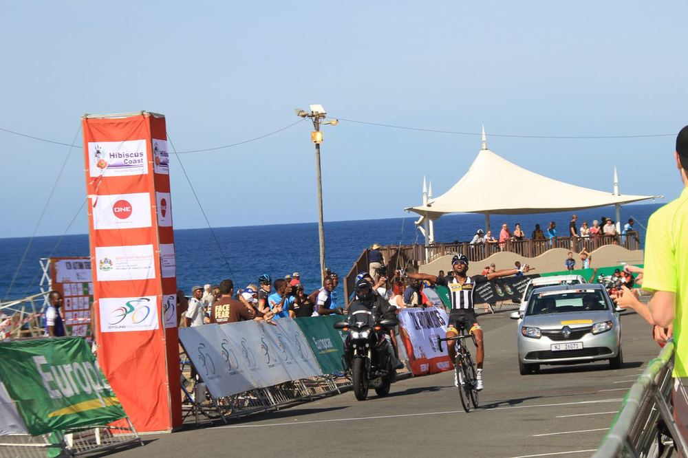 Metkel Eyob Teweldeberhan (MTN-Qhubeka Feeder Team) crosses the finish line to take first place at the Hibiscus Coast Cycle Challenge in Margate on Sunday 3 May 2015. Photo: supplied