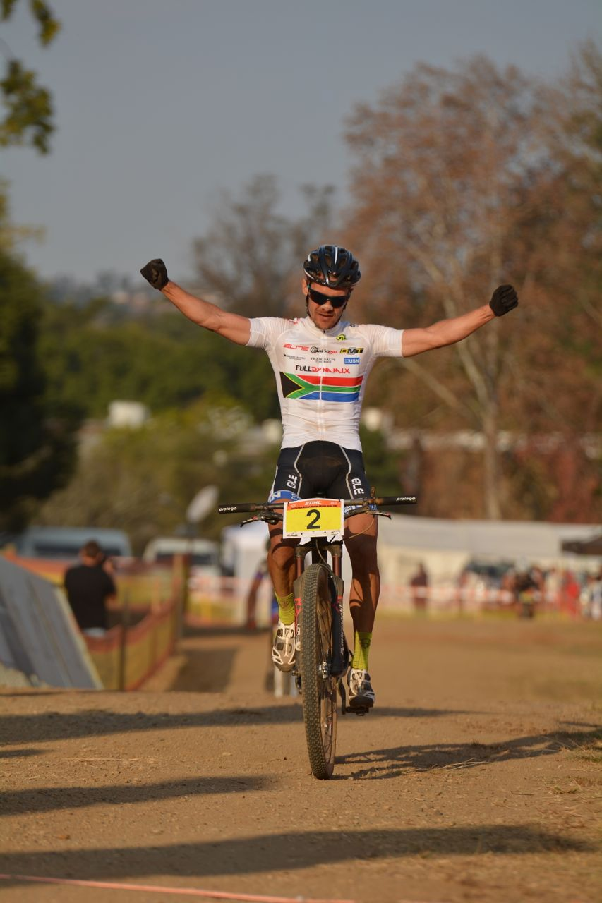 Rourke Croeser (Team Full Dynamix) crosses the finish line in first place in the Elite Men's race at the fourth round of the 2015 Stihl SA MTB Cup XCO at Cascades, Pietermaritzburg, on 27 June. Photo: Gavin Ryan/Quick Pix