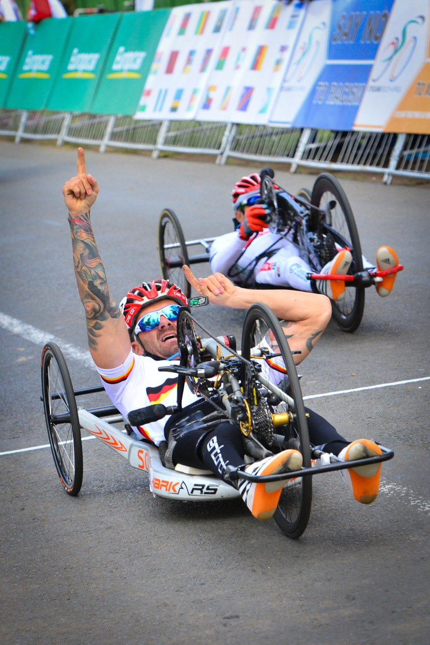 Vico Merklein (GER) celebrates his victory as he crosses the finish line in the H4 road race on day two of the 2015 UCI Para-cycling Road World Cup in Pietermaritzburg on Saturday 12 September. Photo credit: Darren Goddard
