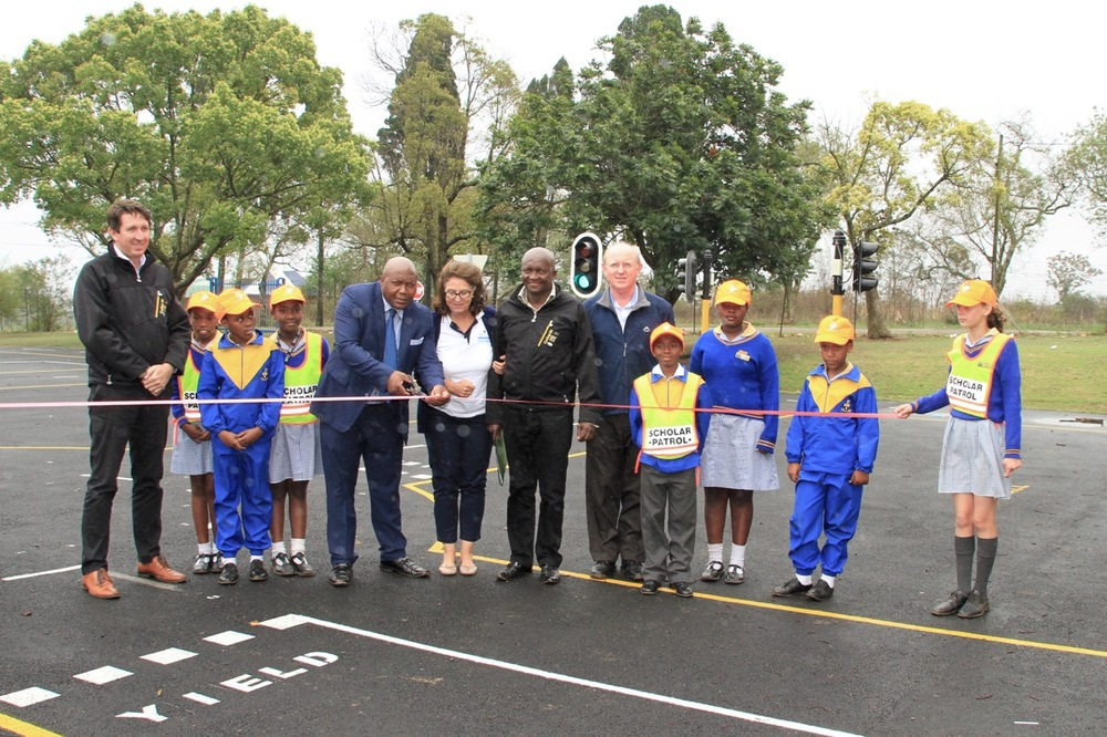 (from left) Mike Bradley (Cycling SA General Manager), George Cato Primary School Principal Mr Magwaza, Tsogo Sun Amashova Durban Classic Race Director Annie Batchelder, Cycling SA's Transformation and Development Commission Director Yster Xatasi, KwaZulu-Natal Sport and Recreation's Duncan Poole, with scholar patrol learners at the launch of the second Amashova Road Safety Bike Park, at the George Cato Primary School in Cato Ridge, KwaZulu-Natal on Thursday 1 October. Photo: Supplied