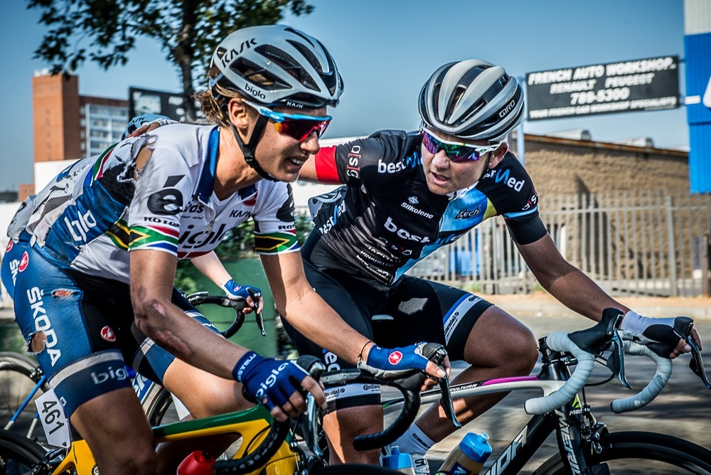 Multiple National Champion and women's cycling stalwart, Anriette Schoeman (BestMed ASG Women's Team) rides alongside race winner Ashleigh Moolman-Pasio (Bigla Pro Cycling Team) in a show of support for her compatriot after her high speed crash in the Momentum 947 Cycle Challenge UCI 1.1 women's race in Gauteng earlier today. Photo: supplied/Momentum 947 Cycle Challenge.