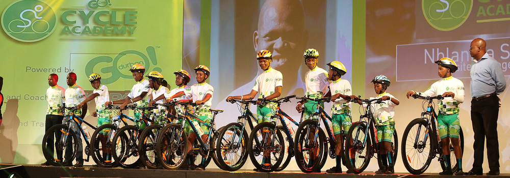 he first group of young cyclists in the new GO!Durban Cycle Academy located at eNanda Adventure Park. Park manager Nhlanhla Sibiya stands on extreme right. The Academy was launched on 11 February with plans to roll-out seven sites across designated parks around Durban.