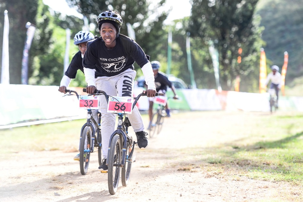 Owami Khumalo (56) and Fezile Linda (32) race hard in the 13-14 Boys category during the District Development Series Finale at the 2016 Pietermaritzburg MTB Festival at Cascades MTB Park on Sunday 1 May. Photo: Darren Goddard