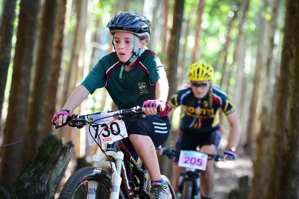 Georgia Finnis of Hillcrest Primary School in the Sprog category followed by Elite rider Frankie du Toit during the KwaZulu-Natal Schools Challenge at the 2016 Pietermaritzburg MTB Festival at Cascades MTB Park on Monday 2 May. Photo: Darren Goddard