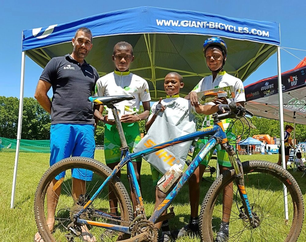 Caption to photo (supplied): Shaun Peschl of Peschlsports Pro Development, official mentors of the GO!Durban Cycling Academy (Left) with the three juniors that took podium positions at the Roag Stihl Sharks Classic that was held in Shongweni on Sunday from left to right: Sabelo Ngcono (2nd) , Blessing Ndlovu (1st) and Collin Gumede (3rd).