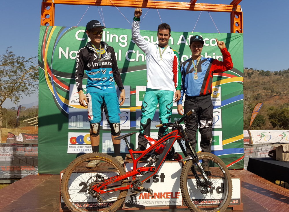 "Johann ""Pottie"" Potgieter gave an excellent performance and cruised to victory ahead of Stefan Garlicki (left) and Christopher Philogene (right) at the 2017 SA National DHI Championships at Mankele MTB Park on Sunday 23 July. Photo: Supplied."