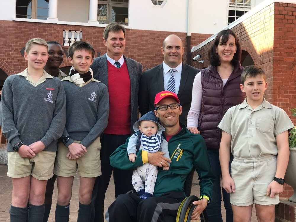 Pieter du Preez presented a talk at Cordwalles Preparatory School on Monday 28 August.Du Preez is in town to take part in the 2017 UCI Para-cycling Road World Championships from Thursday 31 August – Sunday 4 September.(From left to right) Declan Sawyer, Clement Chuuya, Alex Barnard, Mr Lance Veenstra (Headmaster), Mr Luke Hounsom (Junior deputy head - Sport) , Illse Du Preez, Jordan Anastasis (far right) and Pieter Du Preez with baby Pietman (front).