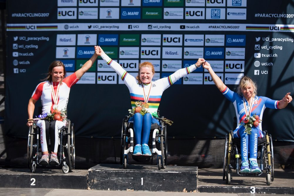 Italian gold medallist Francesca Porcellato is elated during the podium ceremony for the Women's H3 event. She is flanked by Renata Kaluza (POL, left) and Anna Oroszova (SVK, right) during the Time Trial on Day 1 of the 2017 UCI Para-cycling Road World Championships held at Midmar Dam Howick, South Africa, on Thursday 31 August 2017. Photo credit: Andrew Mc Fadden