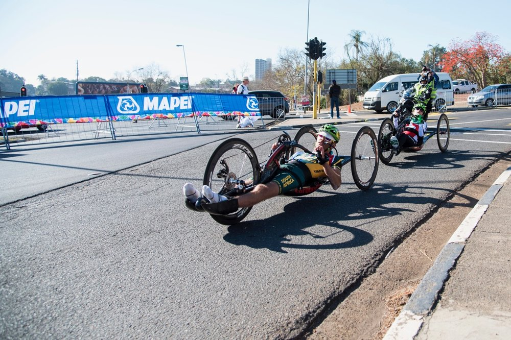 "Pieter ""Supapiet"" du Preez (front) took the race to Swiss rider Benjamin Fruh (back) to secure the first gold medal for Team South Africa during the Road Race on Day 3 of the 2017 UCI Para-cycling Road World Championships held at Alexandra Park Pietermaritzburg, South Africa, on Saturday 2 September 2017. Photo credit: Andrew Mc Fadden"