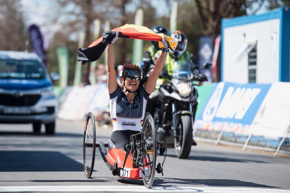 Finishing solo, Germany's Andrea Eskau has time to proudly lift her national flag as she celebrates her victory in the H5 race during the Road Race on Day 3 of the 2017 UCI Para-cycling Road World Championships held at Alexandra Park Pietermaritzburg, South Africa, on Saturday 2 September 2017. Photo credit: Andrew Mc Fadden