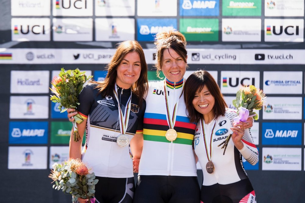 Newly crowned UCI Women's C3 World Champion Anna Beck (SWE) is flanked by silver medalist Denise Schindler (GER, left) and bronze medalist Keiko Noguchi (JPN, right) on Day 4 of the 2017 UCI Para-cycling Road World Championships held at Alexandra Park Pietermaritzburg, South Africa, on Sunday 3 September 2017. Photo credit: Andrew Mc Fadden