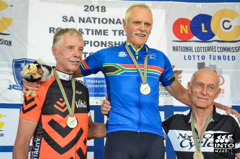 Fred van Zyl celebrates his Time Trial victory in the Masters Men 70-74 class flanked by Willie Bauscher (left) and Geoff Ferreira (right) at the 2018 SA National Road and Para-cycling   Championships, which took place in the streets of Oudtshoorn from 6-11 February. 📷 www.intocycling.co.za