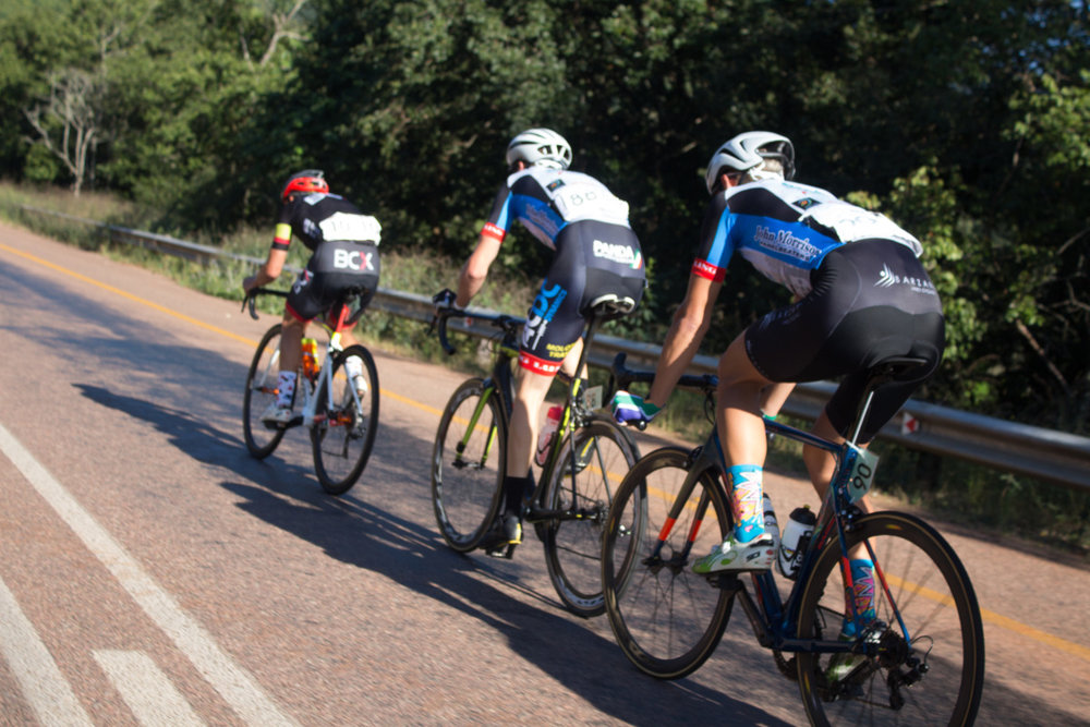David Maree (Team BCX), Jaco van Dyk and Jason Oosthuizen (ACDC Luso) stoke the engine up front on Stage 4 of the Tour de Limpopo from Tzaneen to Polokwane on Thursday 26 April 2018 © Jeanette Kwetepane