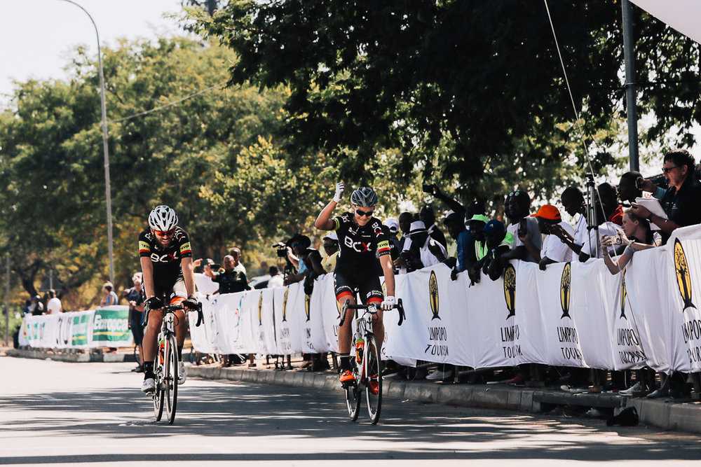 Fist pumps and smiles all round as Marc Pritzen (Team BCX) shows his appreciation for teammate Steven van Heerden's victory on Stage 4 of the Tour de Limpopo from Tzaneen to Polokwane on Thursday 26 April 2018 © HaydsBrown