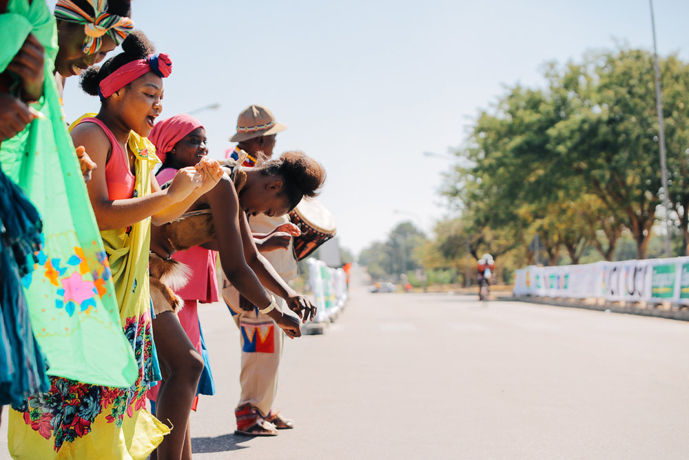 Local traditional dancers display an array of bright colours and sing and dance to welcome the riders home on Stage 4 of the Tour de Limpopo from Tzaneen to Polokwane on Thursday 26 April 2018 © HaydsBrown
