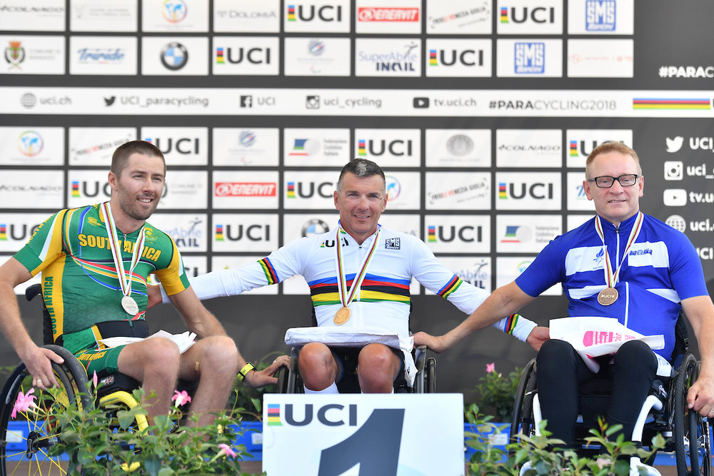 Pieter du Preez won a silver medal in the Road Race at the 2018 UCI Para-cycling Road World Cup in Maniago, Italy - with him is winner Fabrizio Cornegliani (ITA) and third-placed Harri Sopanen (FIN). Photo credit: SWpix.com