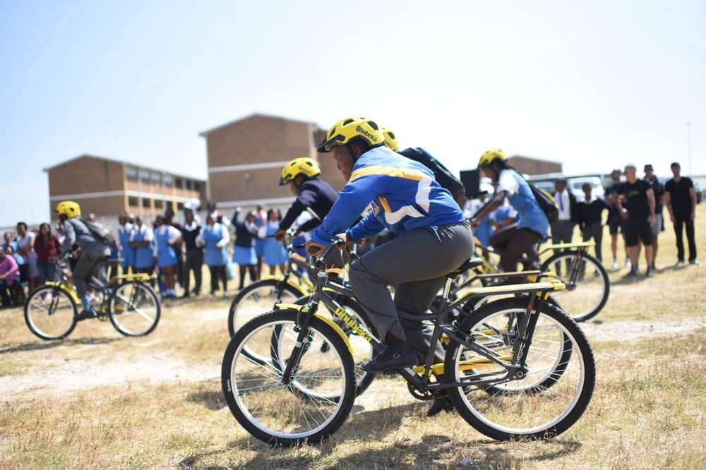 Team Dimension Data for Qhubeka 15 Nov bike handover (2).jpeg
