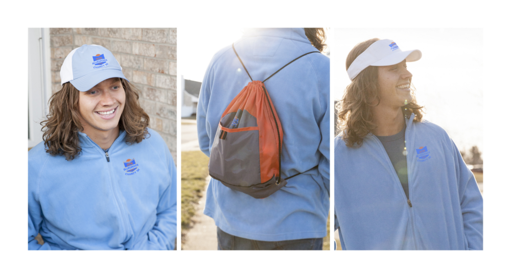 Cap: Style 0442 in Slate Blue; Visor: Style 4324 in White; Jacket: Style1706 in Sport Light Blue; Shirt: Style 1615 in Lake; Cinch Bag: Style 1221 in Pop Orange/Deep Smoke.