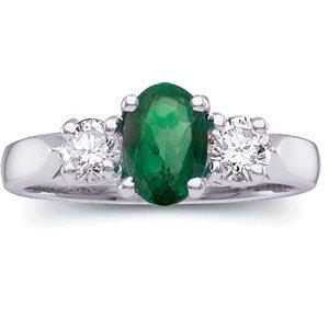 Oval Emerald and Diamond three stone ring.jpg