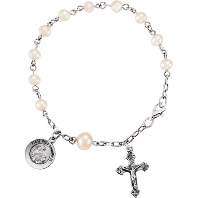 This pearl and silver holy rosary bracelet is equally sweet and demure.  At $100, it's a perfectly giftable price point, too!