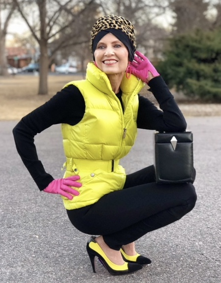 Judith wears an ADD puffer, Ralph Lauren top, JCrew leggings and Prada shoes with a vintage Thierry Mugler handbag from Common Threads.
