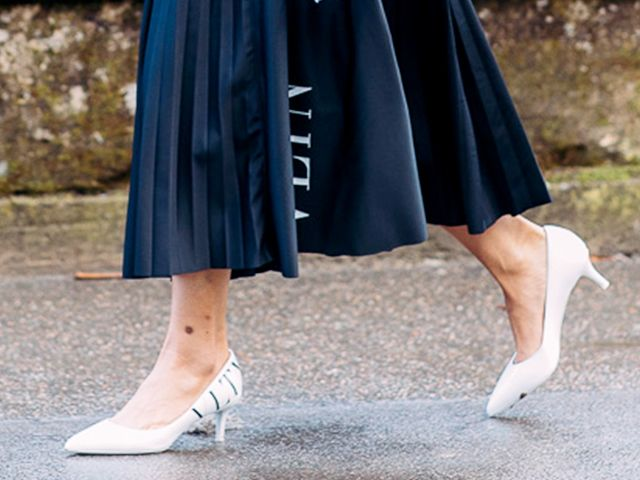 White Kitten Heels with a summer-ready knife pleat skirt; image via Who What Wear.