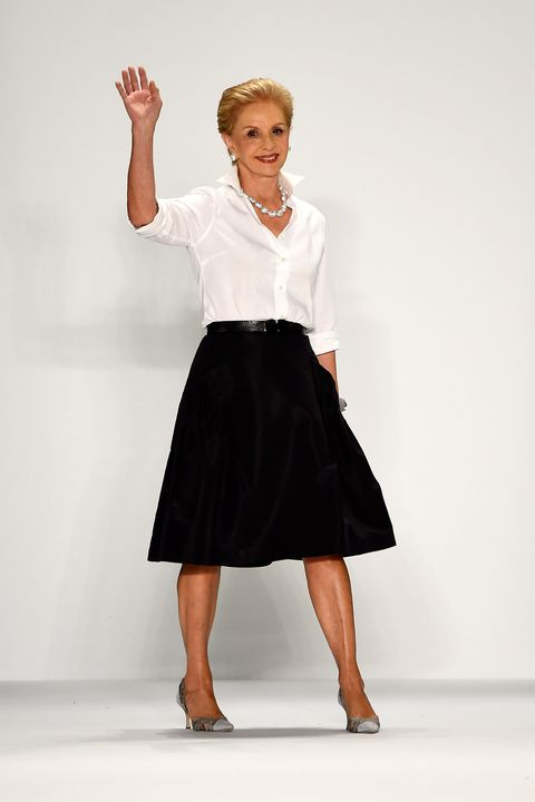 Carolina Herrera's uniform of crisp white button down and dark skirt; image via Harper's Bazaar.