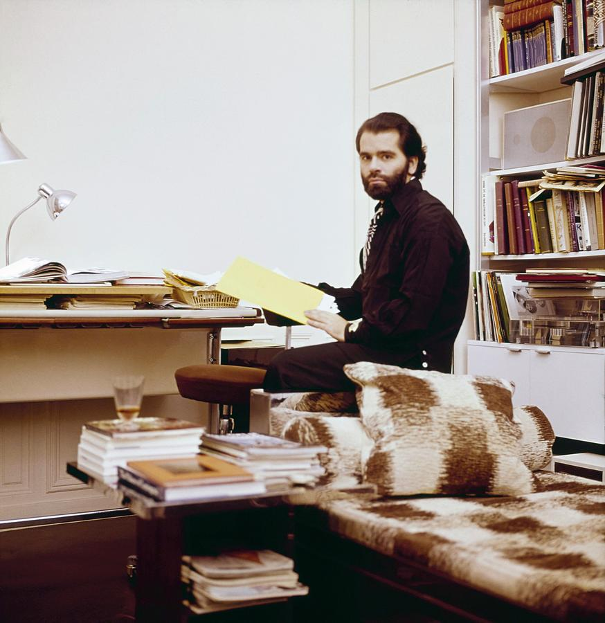 Lagerfeld at his home in Paris, 1974; image via Conde Nast.