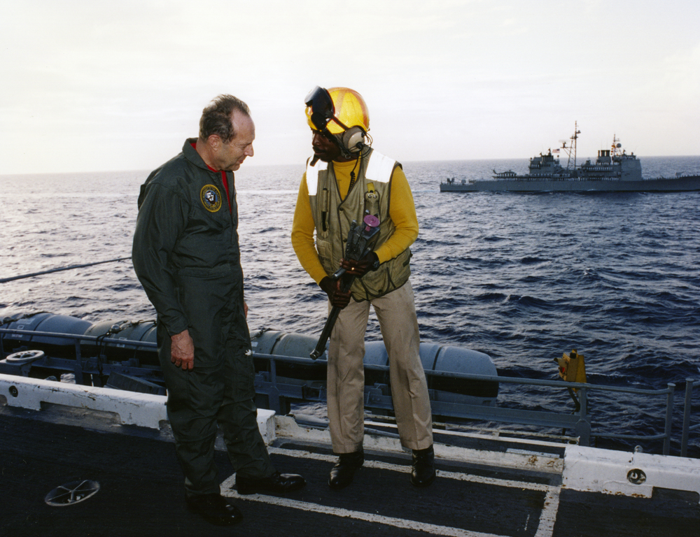 Perry talks with crewmember of USS  Eisenhower , August 1995.