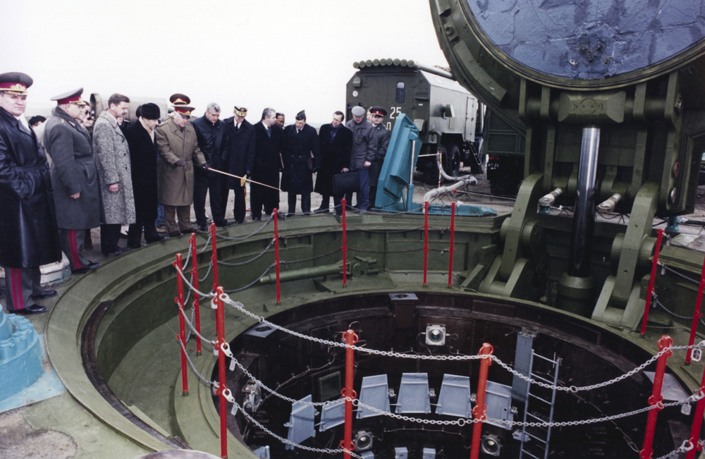 Peering into an underground missile silo on Perry's first visit to Pervomaysk, Ukraine, March 1994.