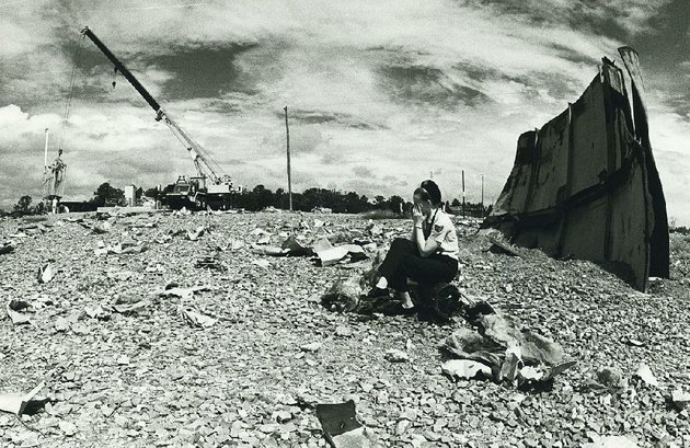 Staff Sgt. Virginia Sullivan, a public information officer at Little Rock Air Force Base when this photo was taken Aug. 27, 1981, sits in the debris field created by a fatal explosion Sept. 19, 1980, at Titan II missile silo 374-7 north of Damascus.  Democrat-Gazette File Photo