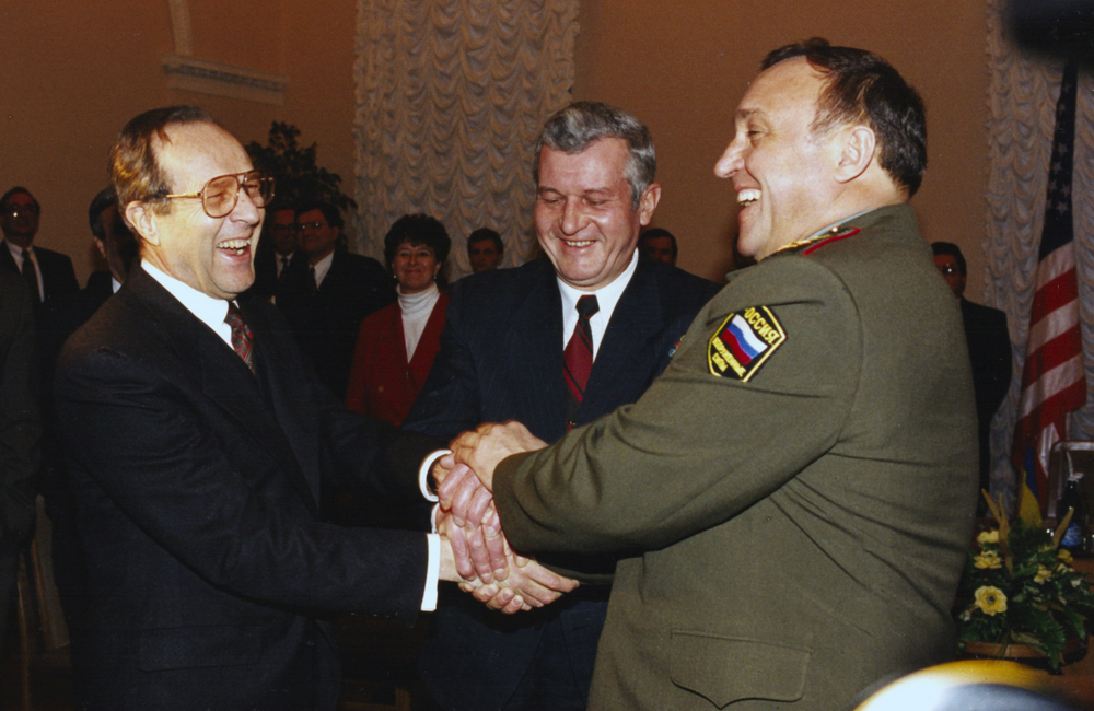 An historic meeting in Kiev, Ukraine: the defense ministers from the United States, Russia, and Ukraine all join hands before a discussion, 4 January 1996.