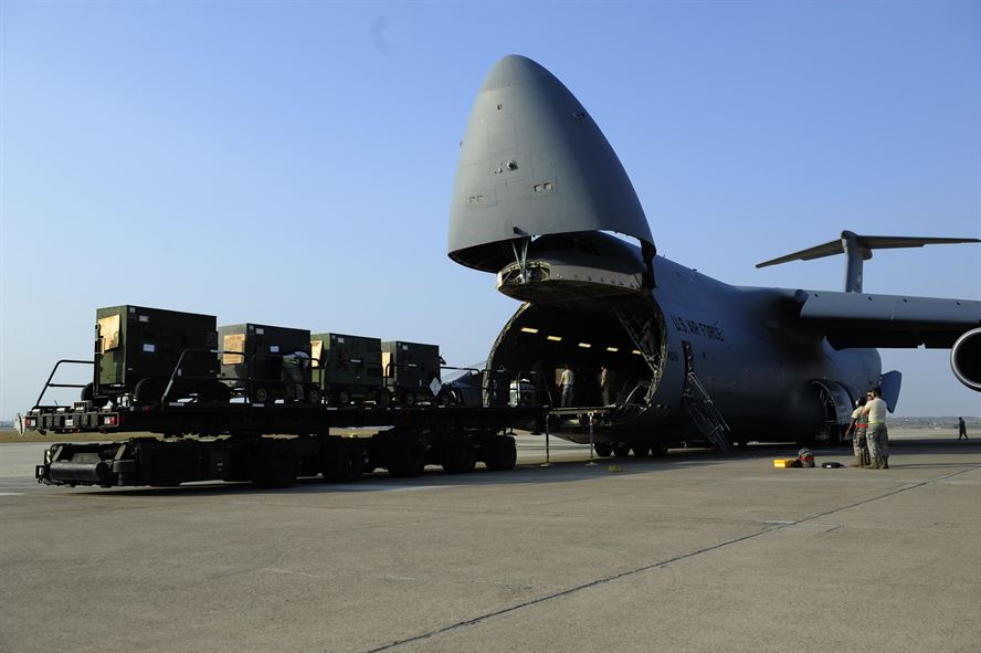 Airmen unload generators off of a U.S. Air Force C-5M Super Galaxy July 22, 2016, at Incirlik Air Base, Turkey. Due to an extended loss of commercial power to the base, supplies, including food, water and fuel had to be delivered to maintain operations. Photo: U.S. Air Force