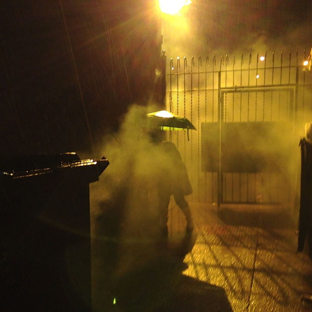 that is me, hidden behind the trash dump in the cold pushing the fog machine in perfectly timed intervals.  yes friends, the highlight of my career so far is the hours I spent in the freezing rain at 2am in an alley of Bushwick on a December night/early morning operating a fog machine.  All those details are true.