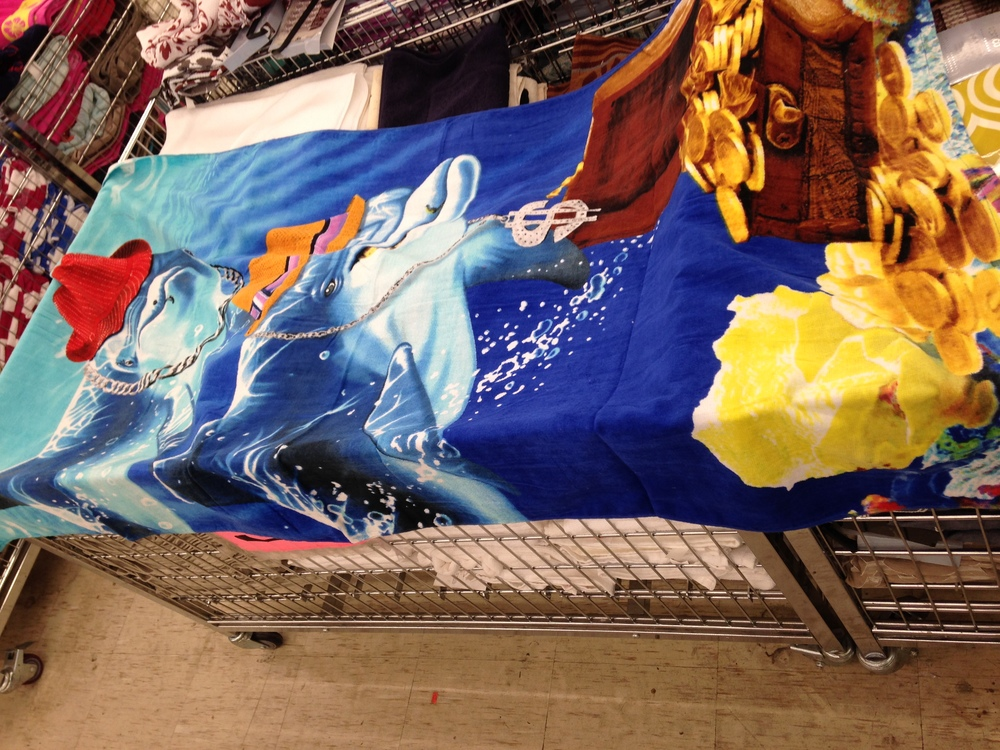 Gangsta dolphins with swagger and bling and a treasure chest of gold on a towel? YES!