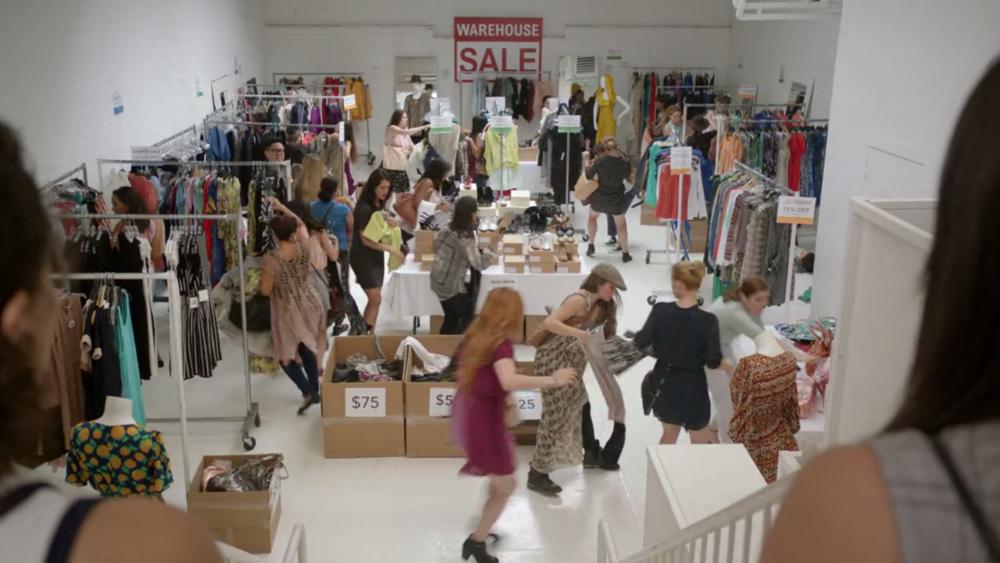 The crazy warehouse sale Abbi and Ilana come upon in Season 3, Episode 1