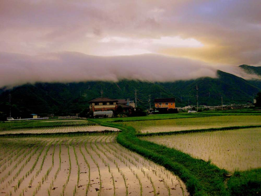 Clouds spilling over the mountains in Ueda.