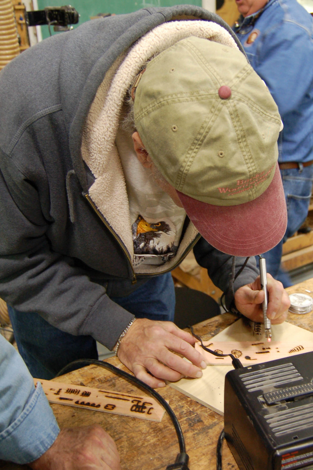 Tom tries his hand at pyrography.
