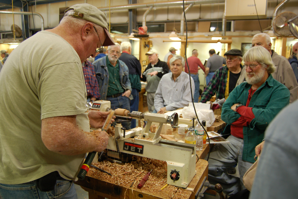 Ed Ryan attracts a big crowd as he turns some basic items ideal for small gifts.