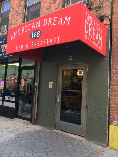 Our bright red awning welcomes you to  your home in the city  – American Dream Hostel!