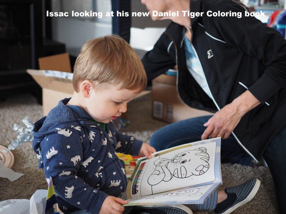 Isaac enjoying his new Daniel Tiger coloring book