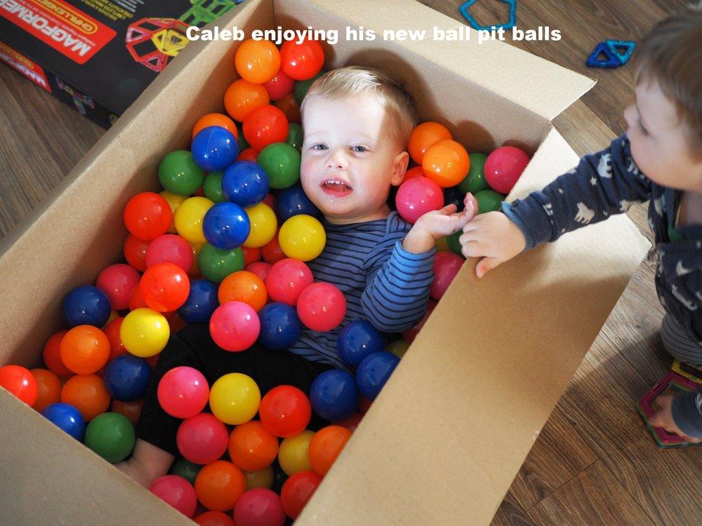 Caleb enjoying his new ball pit balls