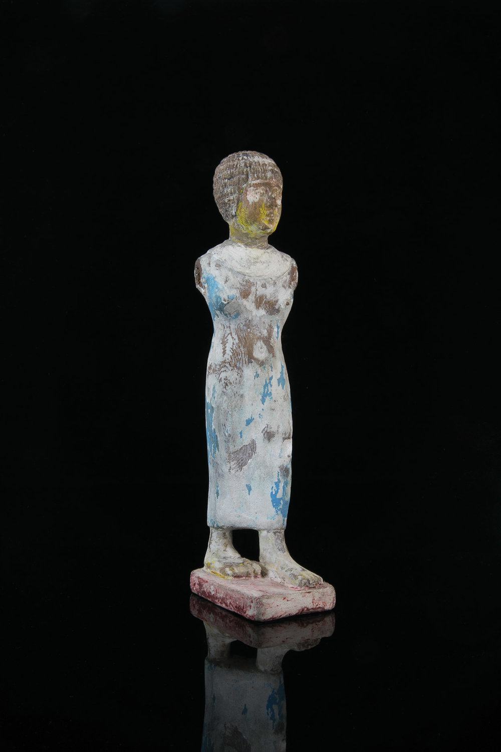 AN EGYPTIAN CEDAR WOOD PAINTED FIGURE OF A WOMAN, Middle Kingdom, Circa 2061-1782 B.C. 28.5cm $20,000