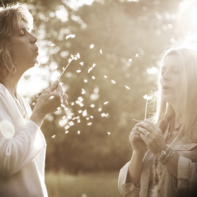 Mikki and Nancy blowing dandelions square.jpeg
