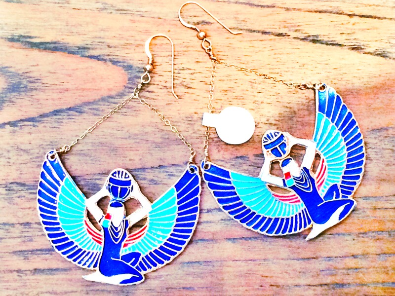 Raquel Greer Gordian exhibits a pair of Egyptian-inspired statement earrings from Leighelena.