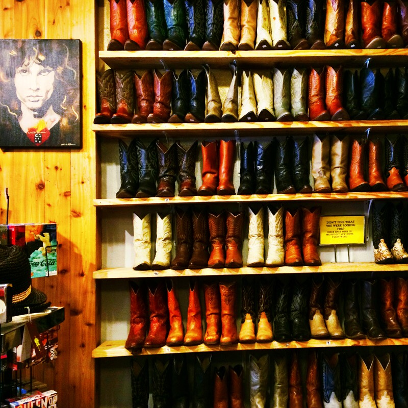Raquel Greer Gordian displays a wall of boots from the Austin boutique Leighelena.