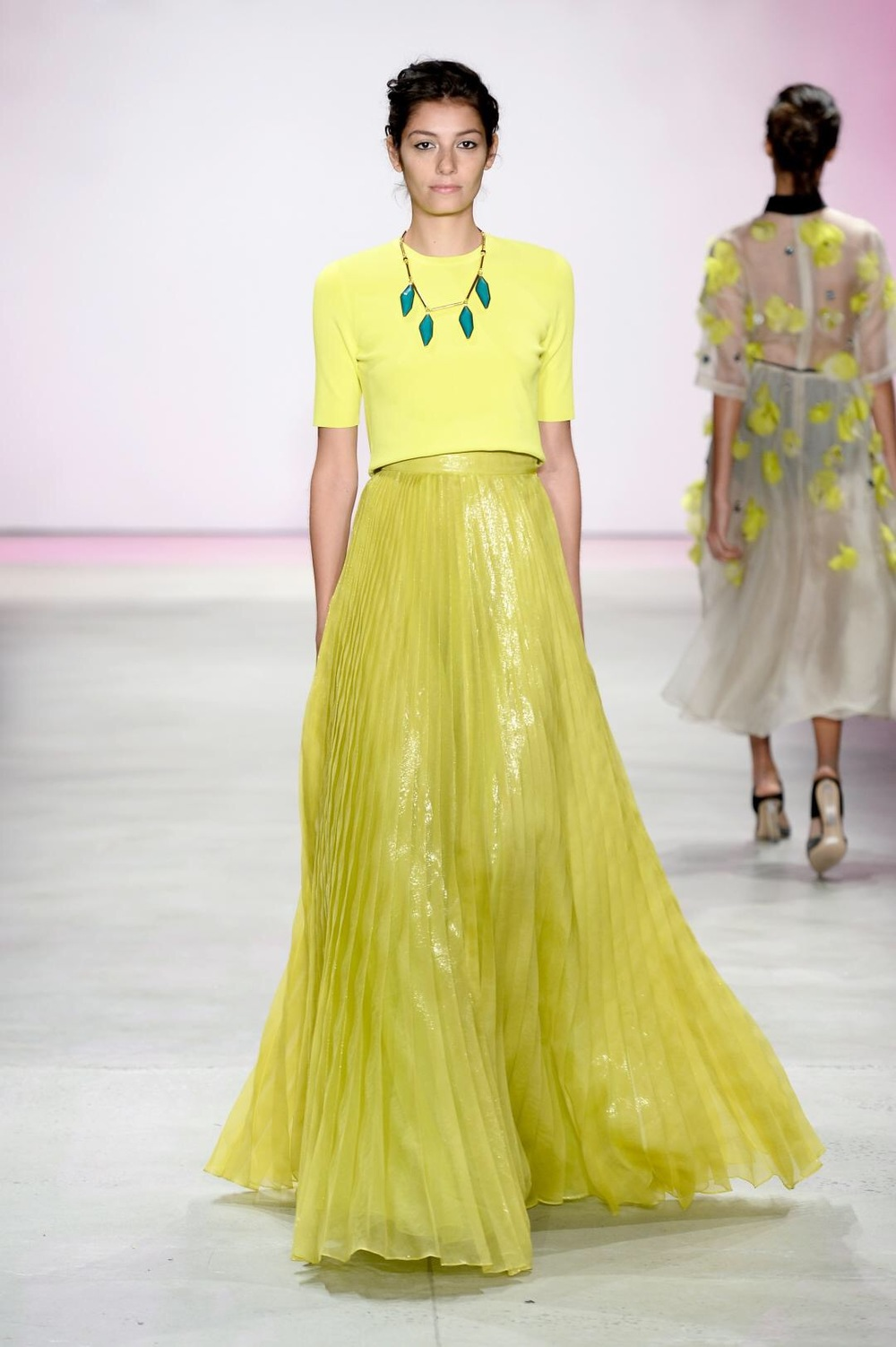 Emily Blanco displays a yellow runway look from Lela Rose.